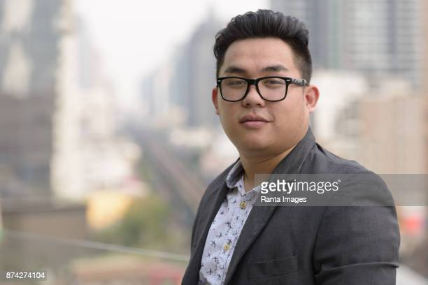 young handsome asian businessman enjoying life in the city of bangkok, thailand - chubby men stock photos and pictures