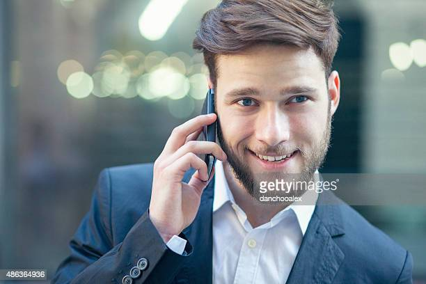 Young handsome businessman taling on the smart phone