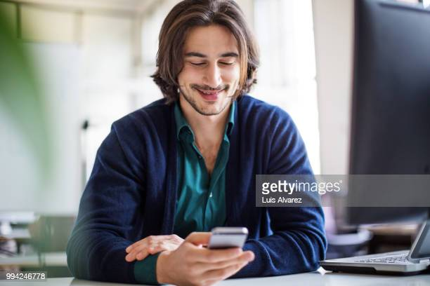 Young handsome businessman using smart phone