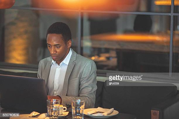 Young handsome businessman working on a laptop