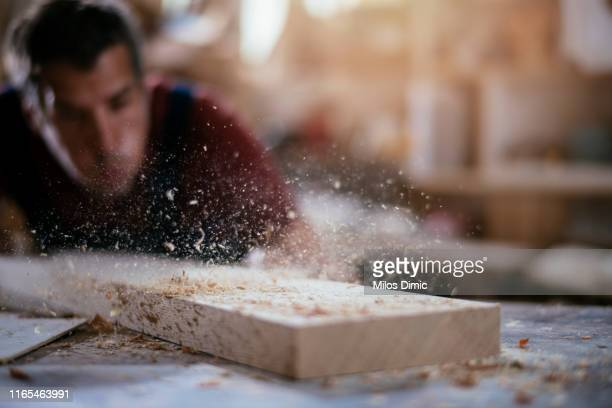 young handsome carpenter stock photo - carpenter stock pictures, royalty-free photos & images