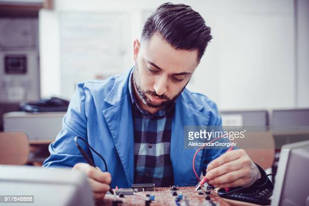 young handsome engineer measuring in the office - oscilloscope stock pictures, royalty-free photos & images