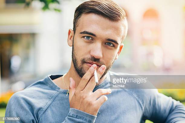 Young handsome male smoking