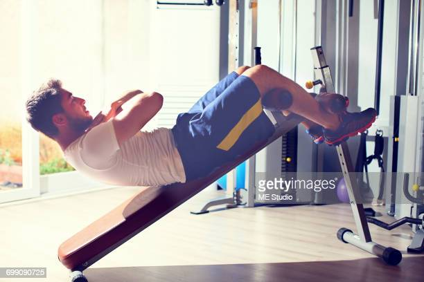 young handsome man doing abdominal muscle workout. antalya ka_ turkey