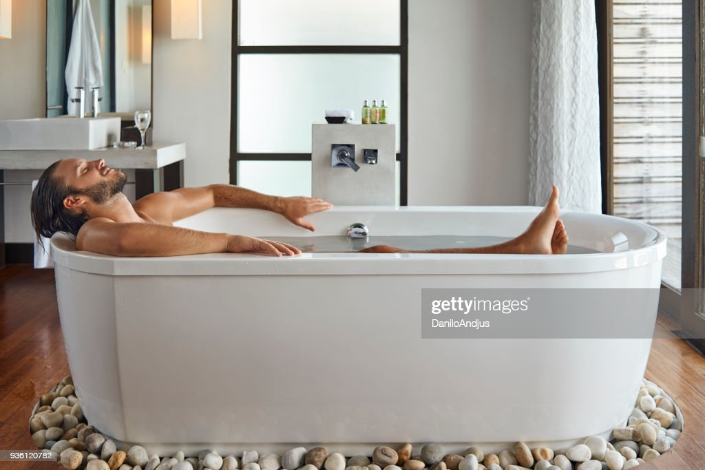 young handsome man enjoying in the bathtub : Stock Photo