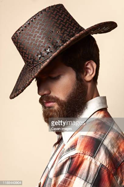 young handsome man in a cowboy hat - metrosexual stock pictures, royalty-free photos & images