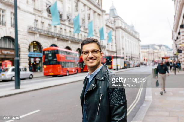 young handsome man in eyeglasses on the streets of london - smart casual stock pictures, royalty-free photos & images