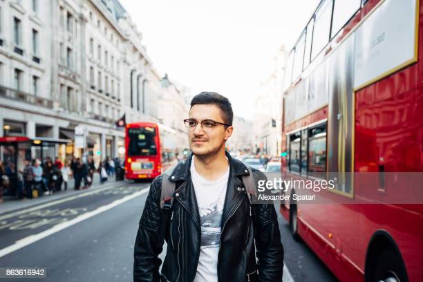 Young handsome man in glasses on the streets of London, UK