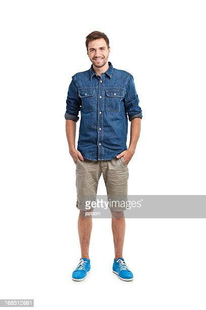 young handsome man in jeans shirt - hands in pockets stock photos and pictures