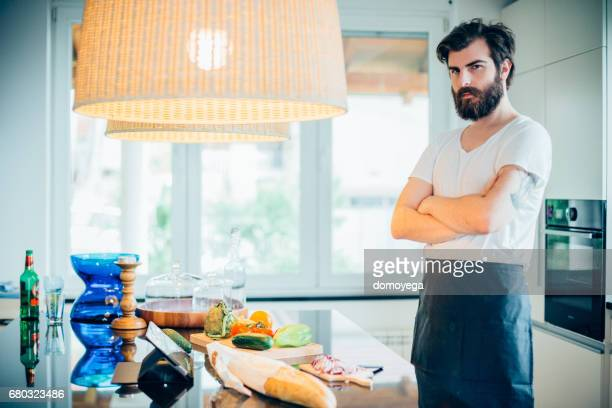 Young handsome man preparing healthy food in the kitchen