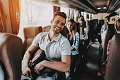 Young Handsome Man Relaxing in Seat of Tour Bus