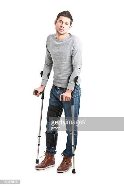 young handsome man with broken leg - crutch stock photos and pictures