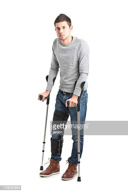 young handsome man with broken leg