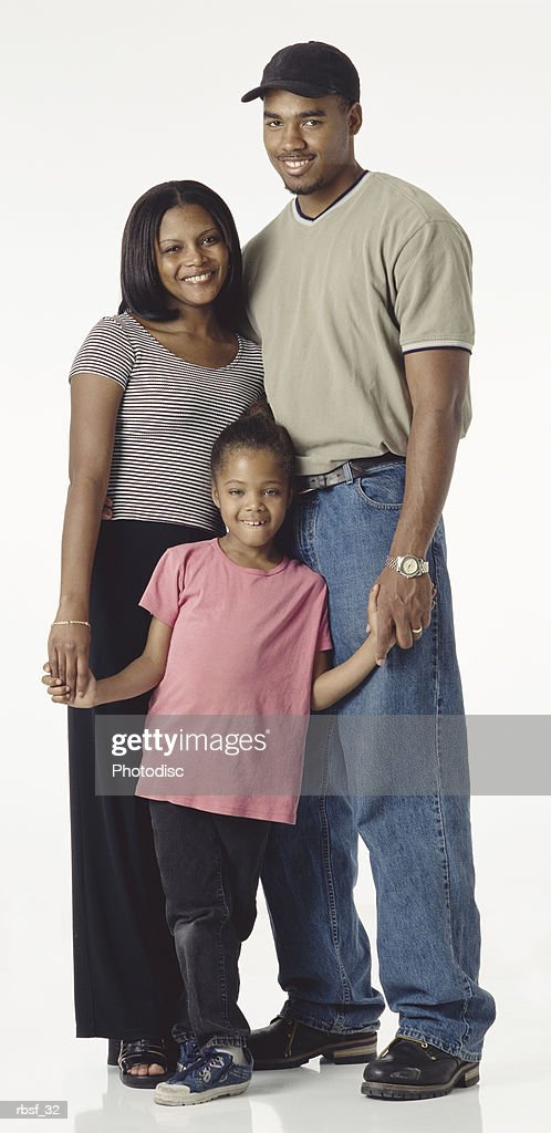young happy african american couple with preteen daughter stand together : Foto de stock