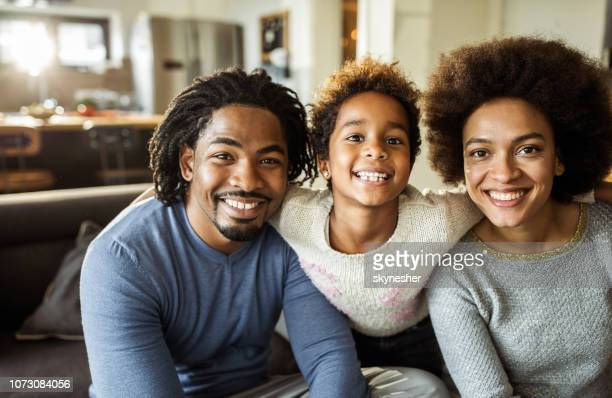 young happy african american family at home. - family at home stock photos and pictures