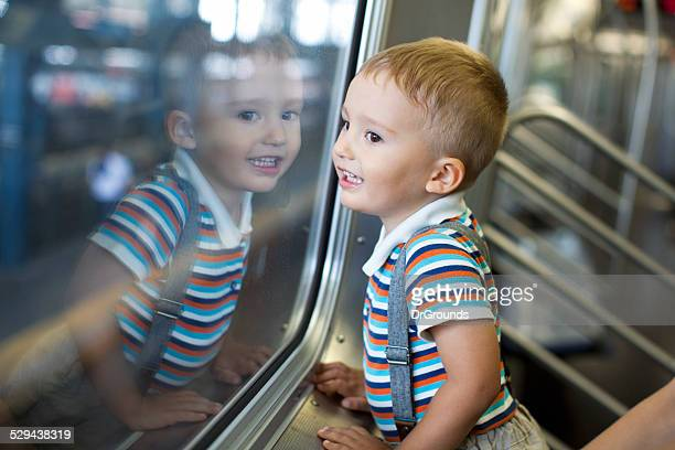 Young happy boy on train