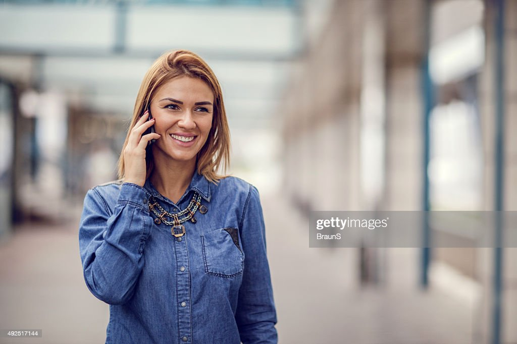 Young Happy Businesswoman Talking On Mobile Phone Outdoors