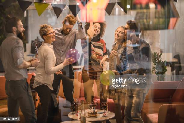 young happy colleagues having fun while dancing at office party. - work party stock pictures, royalty-free photos & images
