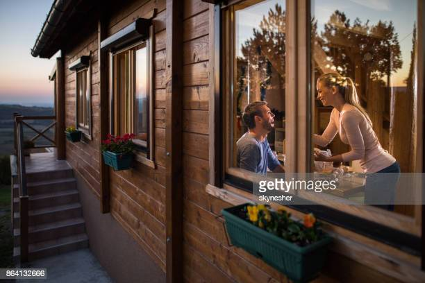 Young happy couple enjoying the weekend in the chalet.