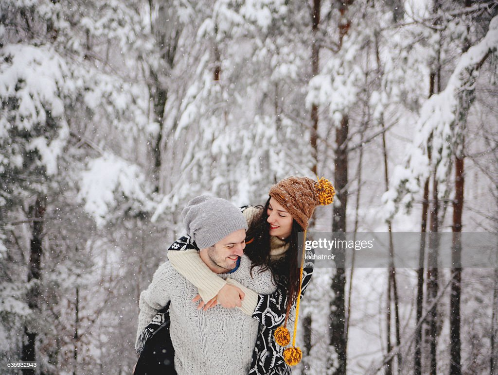 Young happy couple enjoying winter holidays : Stock Photo