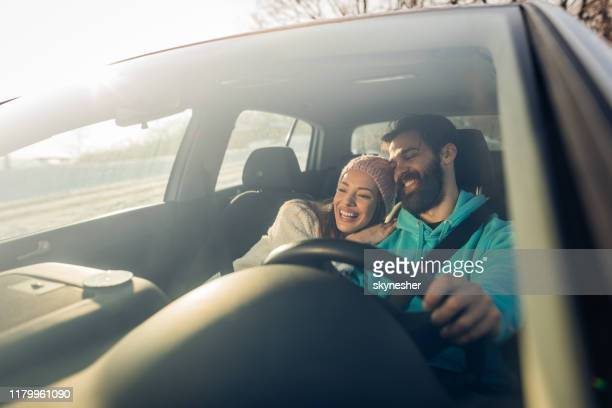 young happy couple going on a road trip by car. - close to stock pictures, royalty-free photos & images