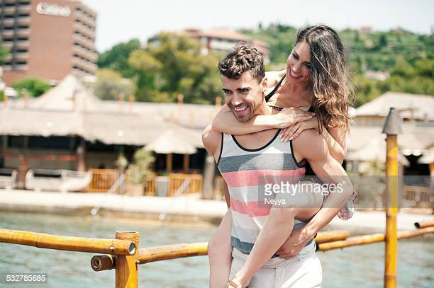 Young Happy Couple having Fun on the Beach