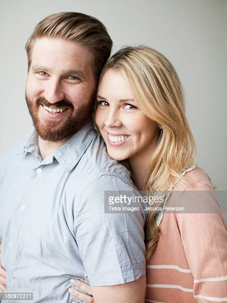 Young happy couple, studio shot