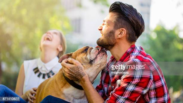 Young happy couple with dog
