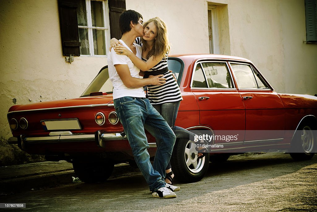 Young Happy Couple With Old Style Car Stock Photo | Getty Images