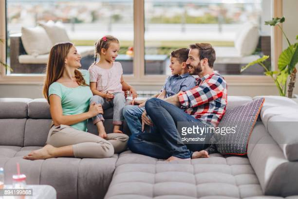 young happy family communicating while enjoying in their time at home. - penthouse girls stock pictures, royalty-free photos & images