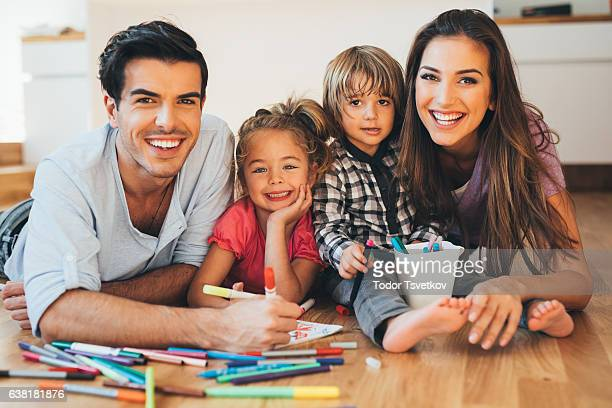 young happy family drawing - family with two children stock photos and pictures