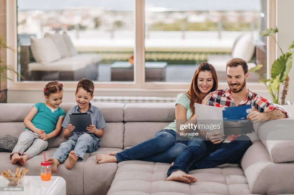 Young happy family enjoying in relaxing day at home. : Stock Photo