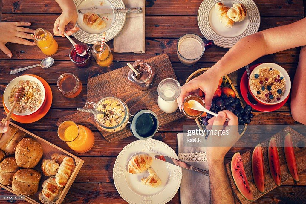 Young Happy Family Having Breakfast : Stock Photo