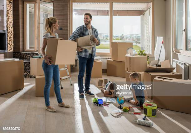 young happy family moving into a new home. - penthouse girls stock pictures, royalty-free photos & images