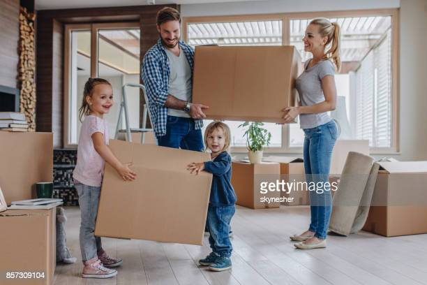young happy family moving into a new house. - penthouse girls stock pictures, royalty-free photos & images