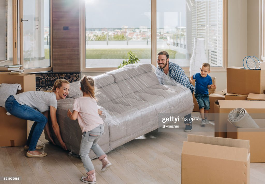 Young happy family moving into new penthouse. : Stock Photo