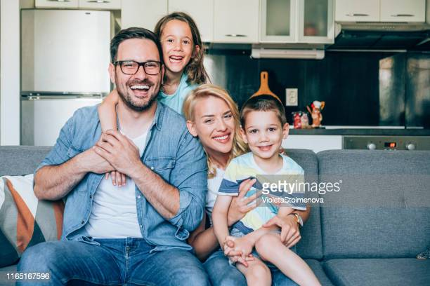 young happy family - family at home stock pictures, royalty-free photos & images