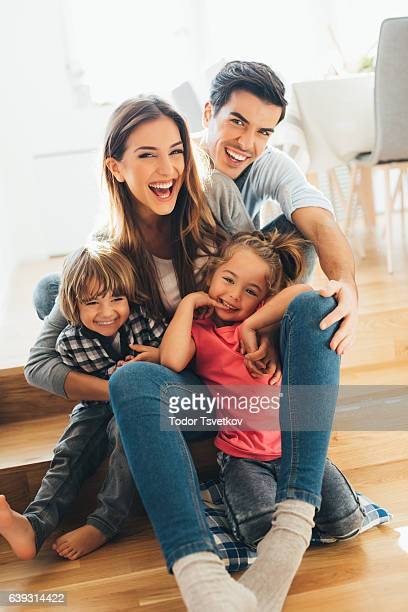 young happy family - family with two children stock photos and pictures