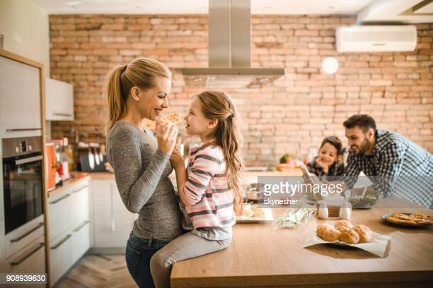 Young happy family spending their free time in the kitchen.