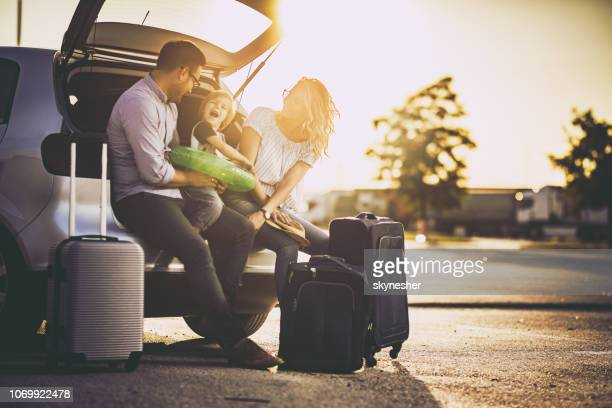 young happy family talking before a trip by car. - férias imagens e fotografias de stock