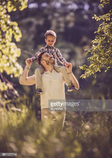Young happy father having fun with his small son in springtime.