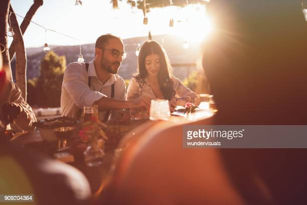 young happy friends having lunch at mediterranean countryside cottage - dusk stock pictures, royalty-free photos & images
