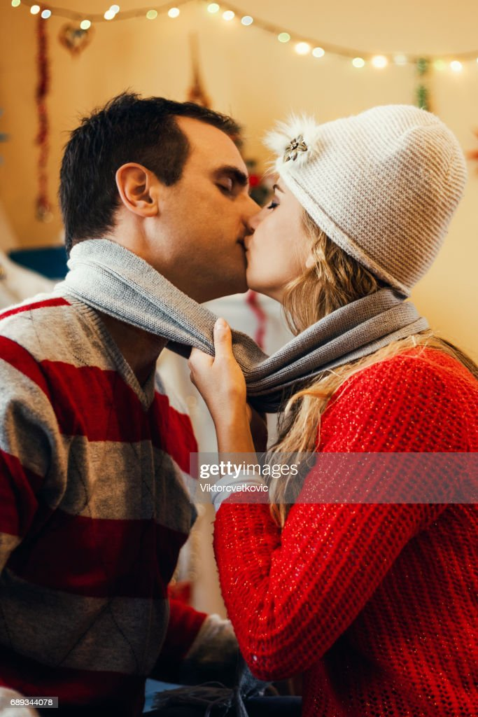 Young happy kissing amorous couple : Stock Photo
