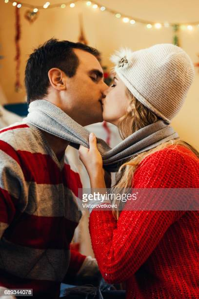 Young happy kissing amorous couple