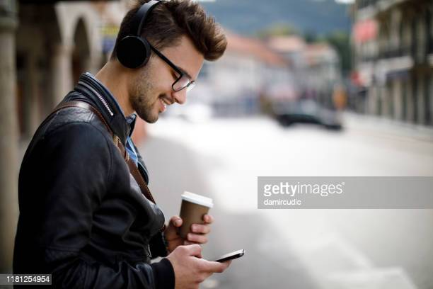 young happy man communting to work - damircudic stock photos and pictures
