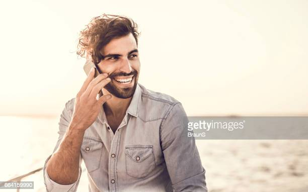 young happy man on the phone in summer day. - north africa stock pictures, royalty-free photos & images