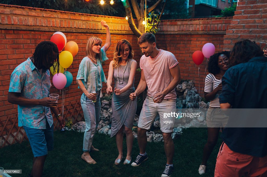 Young Happy People Dancing At Backyard Party Stock Photo