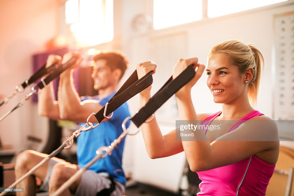 Young happy people exercising on Pilates training class. : Stock Photo