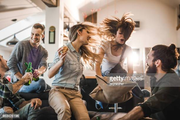 young happy people having fun during a home party in the living room. - festa imagens e fotografias de stock