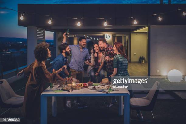 young happy people having fun while dancing on a night party at penthouse balcony. - women of penthouse stock photos and pictures